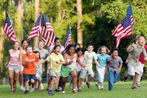 Children Running with American Flags --- Image by © Kevin Dodge/Corbis