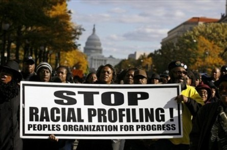 "Thousands of people march around the Justice Department in Washington, Friday, Nov. 16, 2007, during the ""March Against Hate Crimes"" to protest hate crime issues. (AP Photo/Jose Luis Magana)"