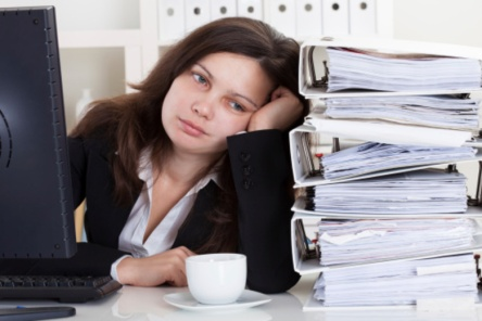 Stressed Woman Working In Office